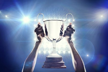 Composite image of cropped hand of athlete holding trophy_91658382_XS