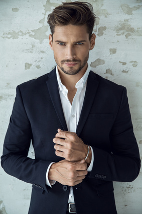 Portrait of sexy man in black suit_118123707_XS